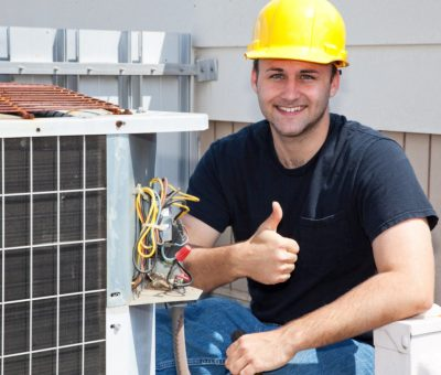 A man sitting beside Air Conditioner