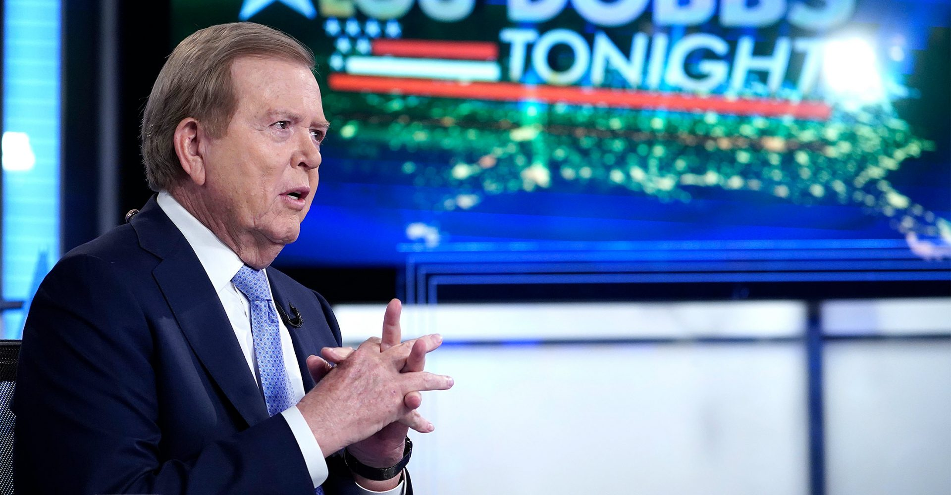 Lou Dobbs wearing a suit and tie