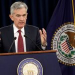 Jerome Powell wearing a suit and tie